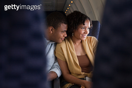 Couple on an airplane - gettyimageskorea