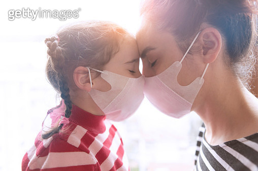 Mother and little daughter wearing surgial mask - gettyimageskorea