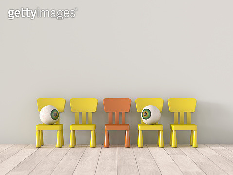 two eyeballs sit far apart on chairs - gettyimageskorea