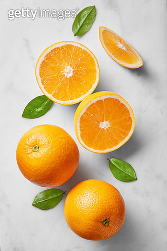 High Angle View Of Oranges And Leaves Over White Background - gettyimageskorea