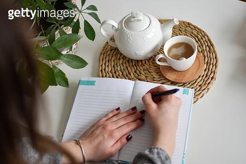 Woman writing her notebook - gettyimageskorea