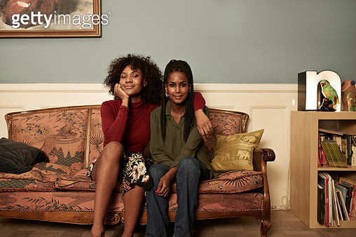 Two young women in sofa at home - gettyimageskorea