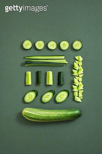 Cucumber on textured green background. - gettyimageskorea
