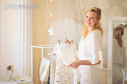 Fashion designer is proudly showing her creation - gettyimageskorea