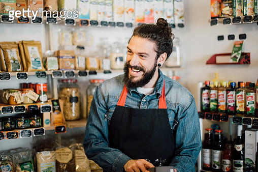 Happy young man at the store - gettyimageskorea