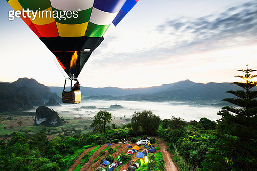 Colorful hot air balloons flying over mountain national park with sunrise and morning mist at Phayao provinceThailand. - gettyimageskorea