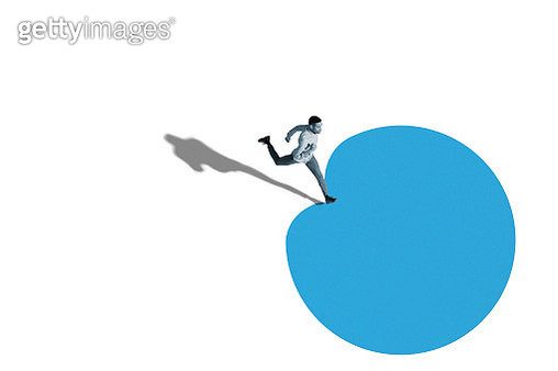 Young man running over blue blob shape - gettyimageskorea