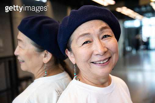 A Japanese active senior woman performs street-style dance in dance studio and street. - gettyimageskorea