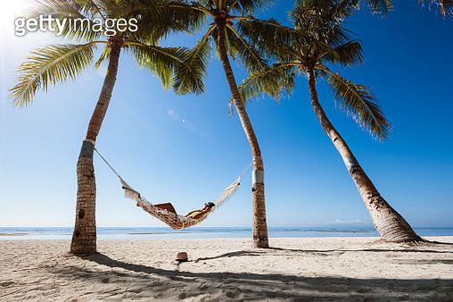 Beautiful asian woman relaxing in a hammock, Panglao, Philippines - gettyimageskorea