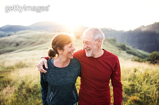 A portrait of old man and woman resting after doing sport outside in the countryside. - gettyimageskorea