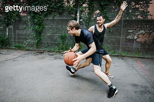 Two Young Urban Basketball Players Battling For Control Of The Ball - gettyimageskorea