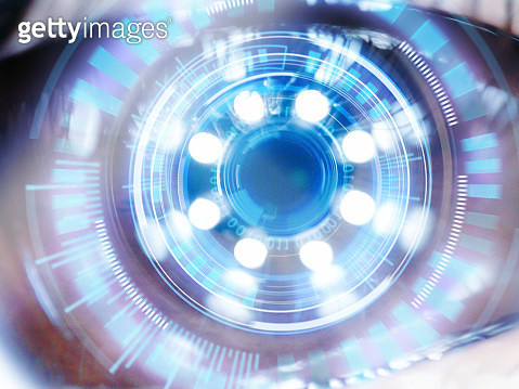 Close up of Asian women with hi tech digital technology screen over the eye. - gettyimageskorea