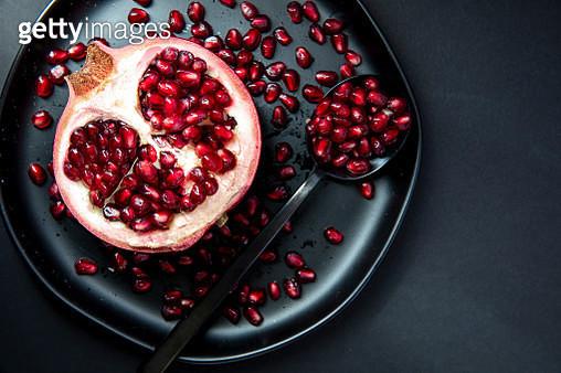 Pomegranate Half on Plate - gettyimageskorea