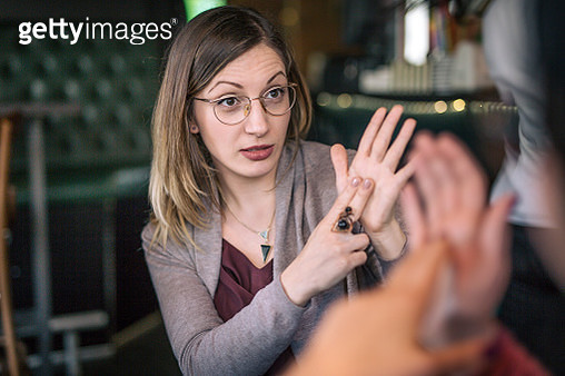 Lovely woman showing a sign - gettyimageskorea