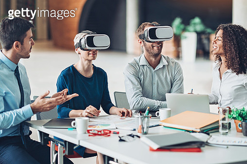Multi-ethnic group of business persons presenting virtual reality technology - gettyimageskorea