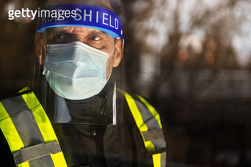 Security staff photographed through window - gettyimageskorea