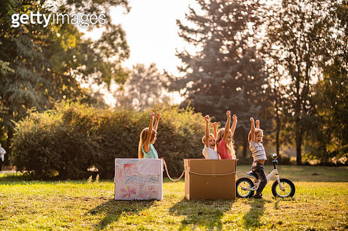 Happy kids made a train of cardboard boxes in public park - gettyimageskorea