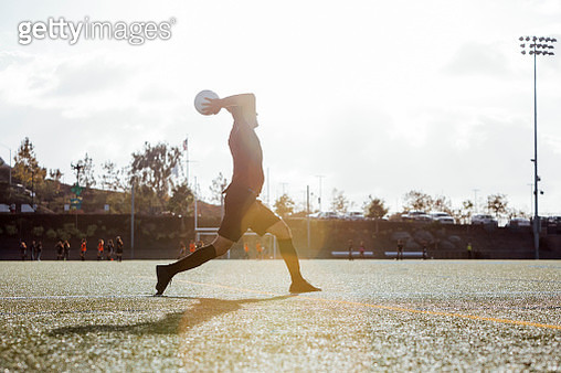 Soccer player throwing ball inbounds - gettyimageskorea
