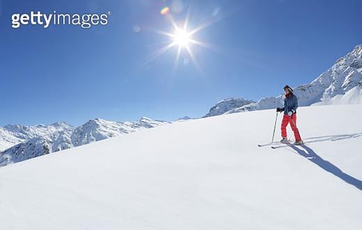 Woman on ski slope - gettyimageskorea
