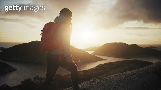 Woman outdoor adventures: hiking in Norway, on the mountain by a fjord - gettyimageskorea
