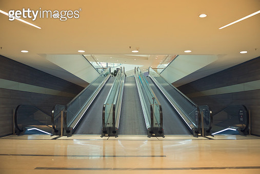 Subway facilities with escalators and stairs without people and futuristic architecture. - gettyimageskorea