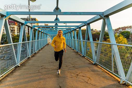 Young Sportsman Running on the Bridge - gettyimageskorea