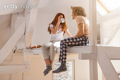 Couple in bed drinking coffee and eating breakfast - gettyimageskorea