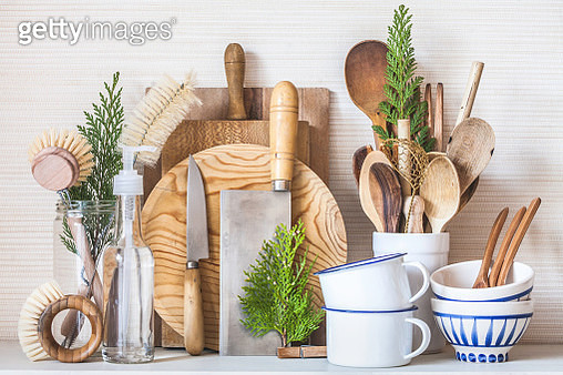 An assembling of items from a zero waste kitchen. Using natural and renewable or biodegradable materials, this kitchen has everything you need to cook and clean your dishes with minimal impact on the environment, and looking elegant at the same time. - gettyimageskorea