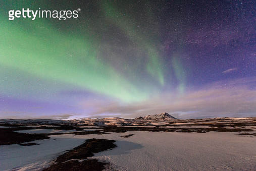 Northern light (Aurora borealis) over Volcanic crater in Northern Iceland. - gettyimageskorea