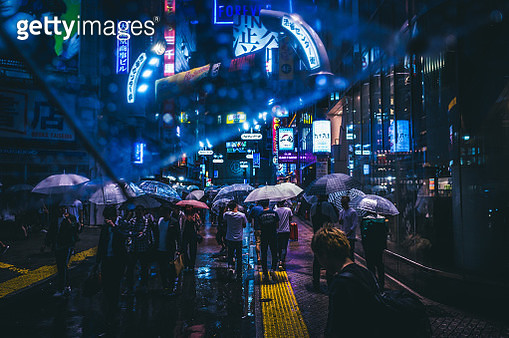 People In Illuminated City At Night - gettyimageskorea
