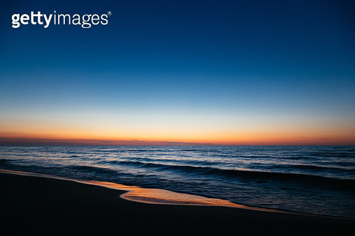 Scenic View Of Sea Against Clear Sky During Sunset - gettyimageskorea