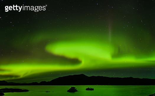 Aurora Borealis above mountain range, Narsaq, Vestgronland, Greenland - gettyimageskorea