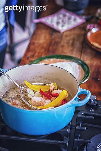 Preparing Fresh Squid to Fry it in Deep Oil - gettyimageskorea