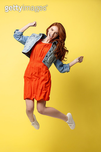 Young Woman Jumping While Against Yellow Background - gettyimageskorea