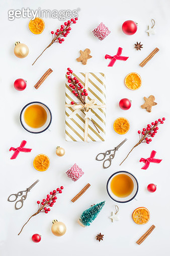 Various Christmas Day decorative items, gift box and cup of hot tea on white background. - gettyimageskorea