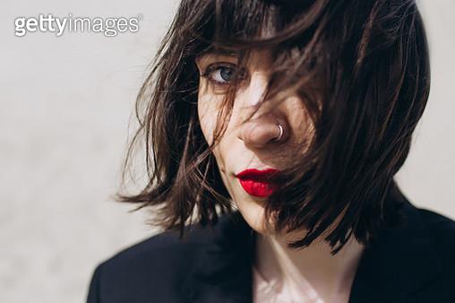 Portrait of a beautiful dark haired woman - gettyimageskorea