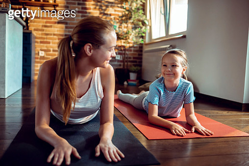 Mother and Daughter doing Yoga - gettyimageskorea
