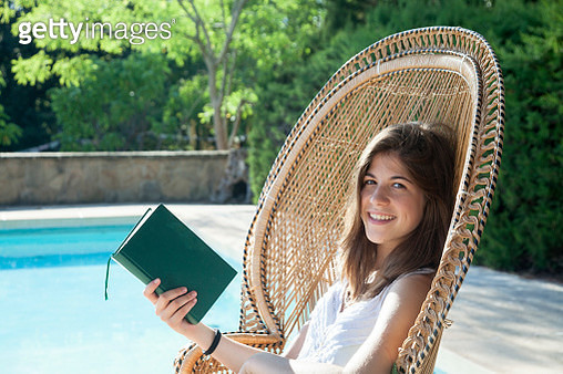 Relaxed girl reading in the pool - gettyimageskorea