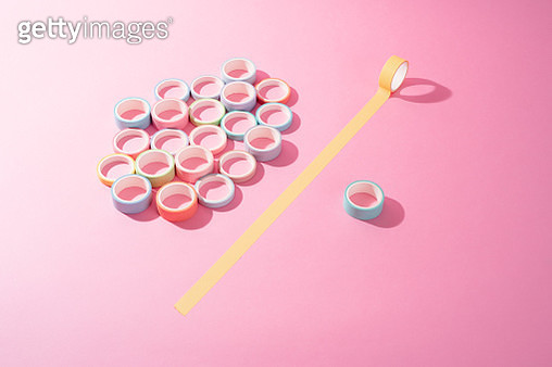 Individuality Concept Adhesive Tapes on Pink Colored Background High Angle View. - gettyimageskorea