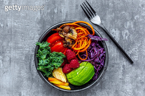 Kale avocado salad with red cabbage, tomato, fried mushroom, carrot, apple and raspberry - gettyimageskorea