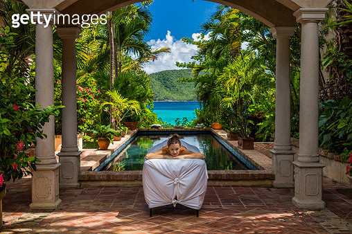 woman receiving a massage at a beautiful villa on St John, United States Virgin Islands - gettyimageskorea