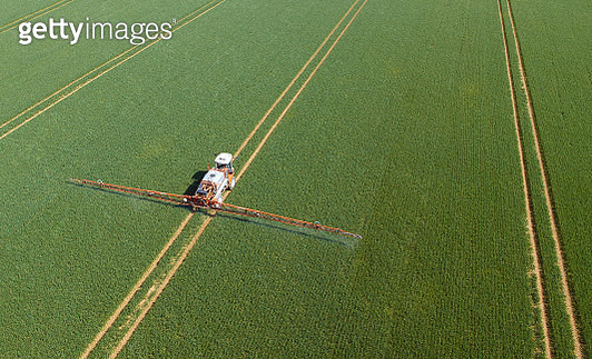 Crop sprayer in field aerial view - Captured by a licensed UAV operator with a permission for aerial work. - gettyimageskorea