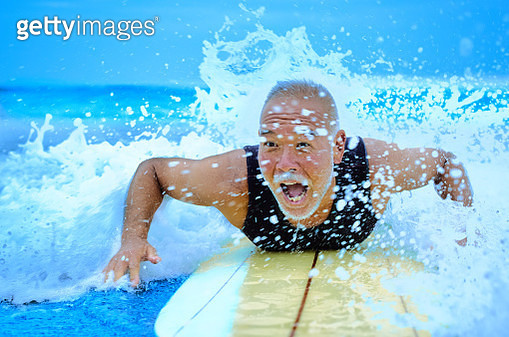 Legendary surfer spills away from everyday and plays with the sea - gettyimageskorea