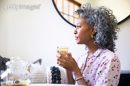 Black Woman with cup of tea relaxing - gettyimageskorea