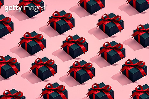A group of gifts are placed in a pattern on a colored background - gettyimageskorea