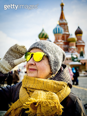 Portrait of senior woman on Red Square in Moscow enjoying the view - gettyimageskorea