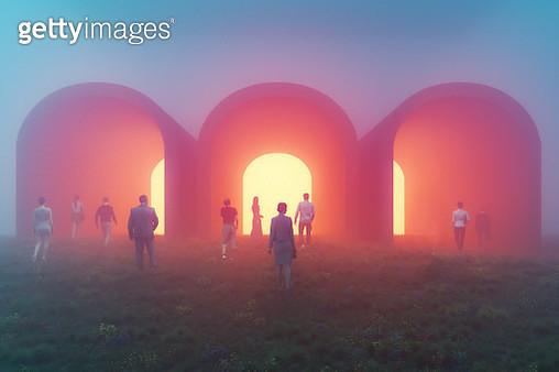 People walking towards mysterious tunnels - gettyimageskorea