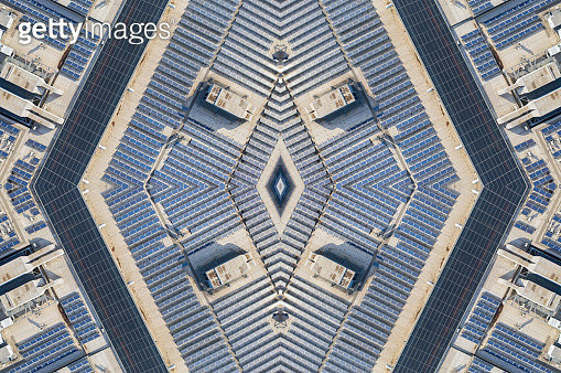 Lines of solar panels at a large solar farm on a shopping centre supermarket roof, aerial view - gettyimageskorea