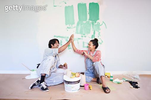 Couple taking break while renovating home - gettyimageskorea