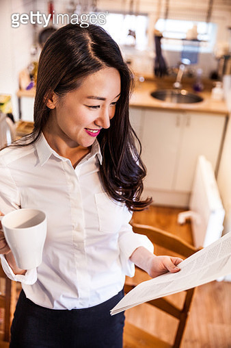 Woman working at home in Seoul - gettyimageskorea
